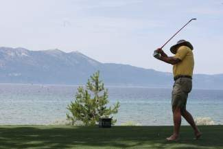 Former NFL quarterback Jim McMahon tees off at hole 17 during the South Tahoe Celeb-Am on Tuesday morning. See more in the sports section of today's Tribune.
