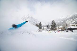A snowboarder slashes through fresh powder Saturday at Squaw Valley. The Truckee/Tahoe region saw anywhere from 2 to 3 feet of snow fall by Saturday afternoon from the weekend storm.