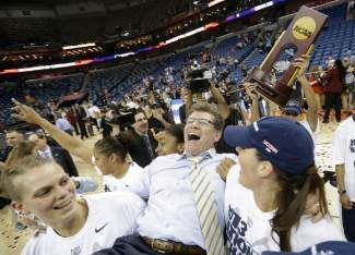 Connecticut players celebrate as they carry head coach Geno Auriemma off the court after defeating Louisville 93-60 in the national championship game of the women's Final Four of the NCAA college basketball tournament, Tuesday, April 9, 2013, in New Orleans.