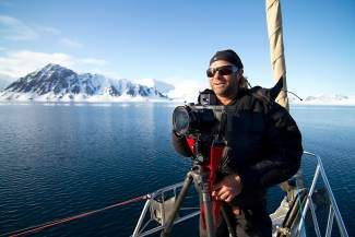 Keoki Flagg is caught by fellow photog Tom Day on assignment for IceAXE Expeditions in Spitsbergen (Arctic Circle).
