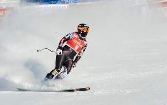 Stacey Cook skis into the finish area in the first Lake Louise downhill training run.