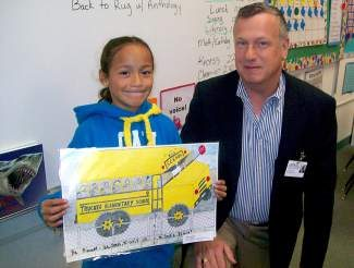 Superintendent Chief Learning Officer Dr. Robert Leri with Joanna Garcia, a Truckee Elementary student who won the school bus poster contest.