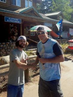 KTKE station owner JD Hoss congratulates Futaleufu trip winner Jake McDermott.