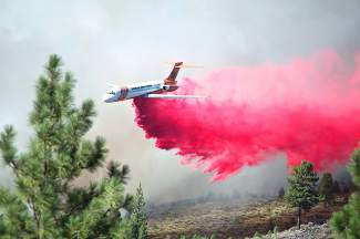 An air tanker drops a load of retardant on the Boca Fire Monday afternoon. No structures were threatened in the fire that burned a few miles north of Lake Tahoe.