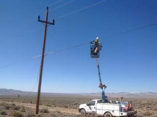 A large portion of a new fiber line across Nevada will be strung from existing utility poles.