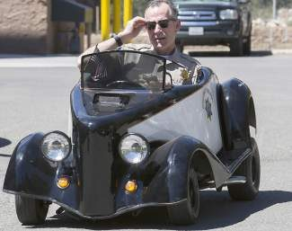 Capt. Malone test drives  the CHP go-cart before the July 4 parade earlier this year.