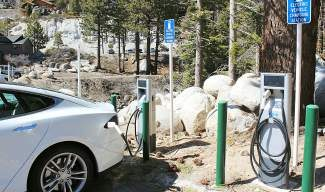 A car uses one of IVGID's new electric charging stations recently at Diamond Peak Ski Resort.
