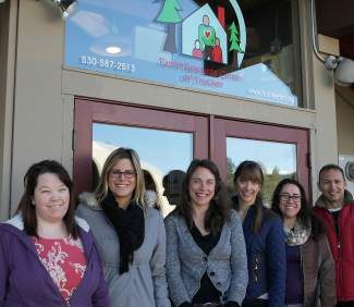 From left are Family Resource Center of Truckee family advocates and AmeriCorps volunteers Jackie McKinney and Jennifer Koch; family services coordinator Maggie Hargrave; program director Emily Diepenheim; legal advocate and mediator Elizabeth Balmin; and managing attorney Brian Gonsalves.