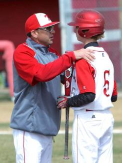 Truckee coach Mike Ellis, shown talking to Teagan Pado in a game last season, was voted Northern Division I-A Coach of the Year. Ellis died from a heart condition on April 5.