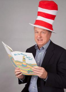 "Dr. Leri dons ""Cat in the Hat"" garb to emphasize the joy and importance of early reading skills."