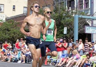 Nick Fresenko and Mike Sunseri race neck-and-neck to the finish line last year in the annual Firecracker Mile run on July 4, 2013. Fresenko won in a time of 4:18.
