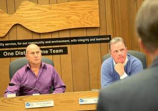 IVGID board chair Bruce Simonian, left, and trustee Jim Smith listen as Incline Village resident Aaron Katz (not pictured) gives public comment at Wednesday's special meeting of the board of trustees.