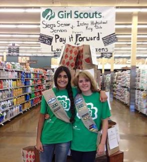 Erika Cory & Serena Singh @ Raley's in front of Care Package bags