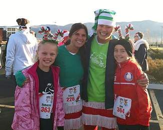 Incline elementary coach Renee Rintala celebrates with Sara Holm and their running buddies at the 2012 Reno Red-Nosed Run.