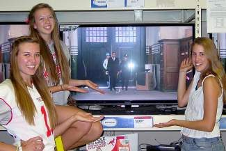 Truckee High School seniors Mackenzie Reddner, Chelsea Mohun, and Elizabeth Costas showcase the Sears Panasonic TV prize.