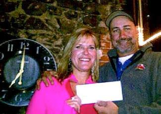 Cindy Lain and Auto and Tire Doctor's John (The Car Whisperer) Lamoreux display a check from last year's $5 oil lube donation for Lain's three-day 2012 San Diego Susan G Koman walk.