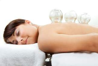 Acupuncture cupping treatment releases toxins from the body and increases the flow of energy, or Qi, as well as blood flow.
