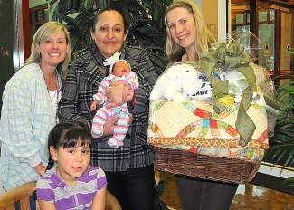 "Tahoe Forest Hospital's ""First Baby 2014"" from left: Vicki Howitt, RN, 5-year-old Eratze, Sandra Solario, new baby Kiara, and Missy Pursel, RN."