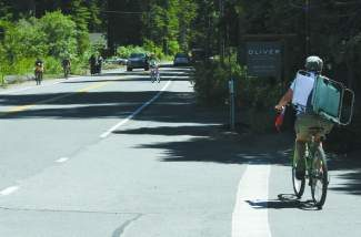 Bicyclists have had to share a narrow stretch of road with motorists near Homewood Ski Resort on the West Shore, as seen in this 2011 photo.