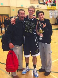 Incline junior Matt Hanna stands with his coach, Tim Kelly, and teammate, Alex Zissis, after winning the slam dunk contest at the Wild West Shootout on Thursday.