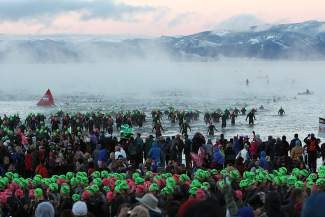 Competitors hit the misty water of Lake Tahoe at the start of the inuagural Ironman Lake Tahoe triathlon last September. This year, the second annual event takes place Sept. 21, and officials are planning several road closures in order to ensure athletes' safety.