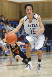 North Tahoe senior point guard Alex Tyler, shown in a game last season, led the Lakers with 22 points in their 63-55 win at Quincy on Monday.