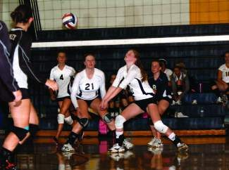 From left to right, North Tahoe's Tilley Gibeaut (4), Taylor Briggs (21), Jordan Briggs (5) and Helana Kearns (8) compete in the Lowry Tournament last season. The Lakers fell in three games to Yerington on Friday.