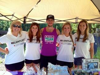 From left, Brittany Vidal, Sabrina Bellici, Warren Kendall, Rebecca Taylor and Kelly Brennan make up Team Warren. The quintet sold pies, cookies and other baked goods at the Aug. 14  Incline Village Farmer's Market at Tunnel Creek, raising $726 toward the team's $12,000 goal, Brennan said.