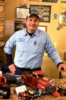 Rigo Garcia, owner of Tanager Street Auto Service, works on a variety of cars, although he said his favorite to repair are Japanese models, and his favorite to drive are German ones.