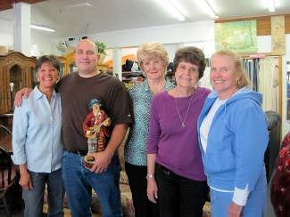 Linda Robins, Tony Conragan, Shirley Degenkolb, Marilyn Henry and Grace Deters all believe in the importance of giving back. Tony, the shop's only paid employee, recently raised $2,500 for the Village Church Youth Group by shaving the beard he had been growing for two years.