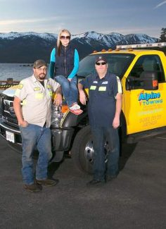 Alpine Towing added two trucks to its fleet this year and services all the North Shore. From left are employees Anthony Smith, Raluca Bogdan and Dave Fowlkes.