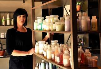"Melissa has had every hairstyle and color possible, from shaved  to bright red ""like a clown."" Now she is au naturale. Coupe Sixty-One uses environmentally friendly and sustainable product lines. All bottles are recyclable and are fully organic."