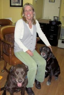 EXL Media owner Wendy Hummer, with her dogs, at the company's office in March 2013.