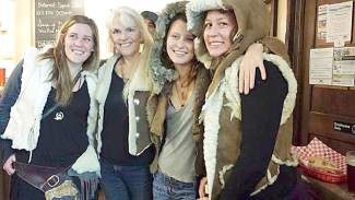 Earthgym students with Jacquie Chandler, wearing sheepskin vests they made in her SNC class.