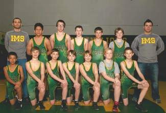 The Incline Middle School wrestling team, top row, left to right: Coach Frank Serrano, Eleazar Arcos Santiago, Esten Flores, Taylor Auger, Ghenadii Zanfirov, Liberty Hanson, coach Jason Roseberry; bottom row: Zach Frogoso, Joe Wilderman, Tyler Eighme, Nolan Galusha, Jake Leonard, Brooklyn Zimmerman, and Keenan Collier. Nico Cruz is not pictured.