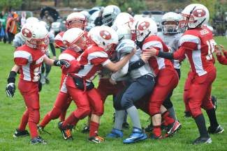 The Pop Warner Truckee Mighty Mites White defense started strong but eventually yielded four touchdowns to the Reno Central Wolf Pack. The Wolverines lost 25-0 under constant, near-freezing rain Saturday.