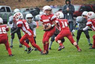Truckee quarterback Tavin Hamilton takes the snap and looks to hand off in Pop Warner action earlier in the year. He threw for a personal-best 106 yards against the Reno North Wolfpack Saturday. The Wolverines won 26-12.