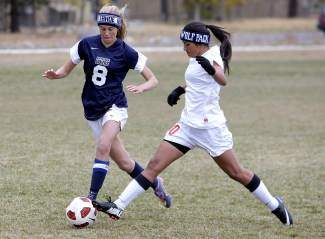 North Tahoe's Kami Abi-Nader and Truckee's Daisy Rivera are shown competing in a soccer match this past season. Starting this winter, the NIAA will require member schools to enter team records through www.maxpreps.com. Teams that do not comply will not be eligible for the postseason.