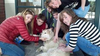 """North Tahoe School students gather round their """"mascot"""" Ellery."""