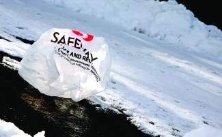 A grocery store plastic bag lies in a Truckee parking lot last winter.