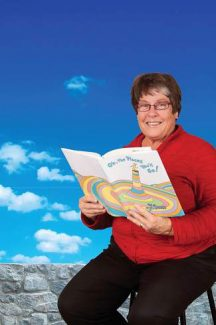 Susan Phebus enjoys reading on a beach with background summer noises.
