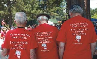 Veterans show off powerful messages on shirts during the 2013 Red, White and Tahoe Blue celebration.