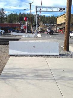 Both concrete barriers near the railroad crossing on Bridge Street, located between Donner Pass Road and West River Street, will be removed as part of a project to create a pedestrian crossing.
