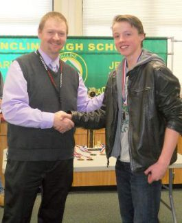 Kealan Pugh receives his medal from Incline High School Site Administrator Mark Zimmerman.