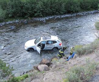 A Sausalito woman was rescued from the Truckee River when the BMW SUV she was driving landed in the water early Wednesday morning.