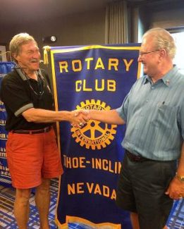 Past President Jim O'Brien, right, turns over leadership of the Rotary Club of Tahoe-Incline to new President, Bruce McNulty.