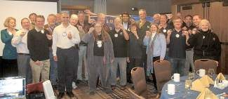"Members of the Rotary Club of Tahoe-Incline show ""we are this close"" to a polio-free world."