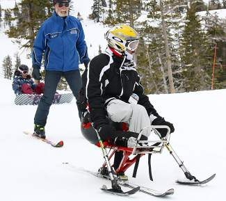 A skier participates in the 2013 Military Winter Sports Camp for disabled veterans organized by Disabled Sports USA-Far West Chapter.