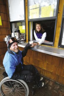 Josh Miller/Sierra SunCindy Smith serves Ed Andreas a cup of coffee at Gentian Cafe at Alpine Meadows on Thursday.