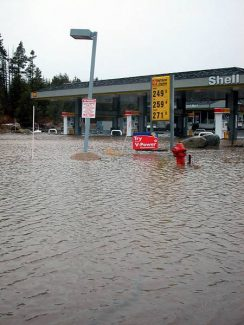 Photo by Tom Falconer The Shell gas station at Highway 89 south near Deerfield Drive was flooded by Donner Creek on Saturday.